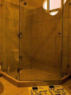 The master bath has both a bathtub and shower