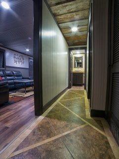 Hallway leading to the two bathrooms.  Travertine & porcelain tile floor