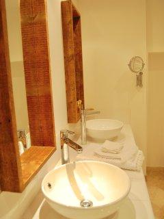 Bathroom 1, en-suite to bedroom 1, two sinks, walk-in Italian power shower