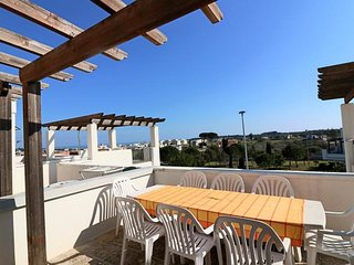 Holiday home in Salento in Puglia a Marittima with large terraces overlooking th