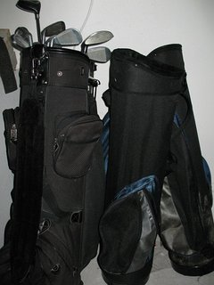 11 golf clubs and 4 carry bags for golf clubs