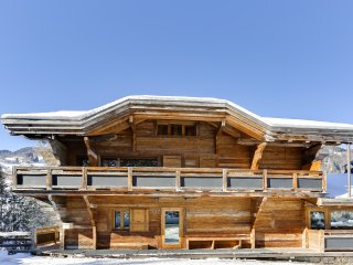 Chalet de grand confort, tradition et modernite