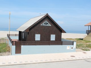 Beach House in front of the ocean, Cortegaca