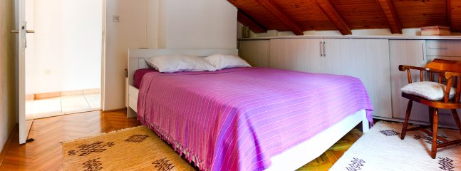 Spacious bedroom includes a king-size bed, and two built in wardrobes