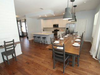 Kitchen with new layout, stainless steel appliances and a table for 12