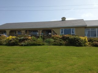 4 Bedroom spacious bungalow with veranda and conservatory with scenic views of sea.
