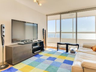 Modern, ocean view condo with a balcony & a shared pool, hot tub, and game room!