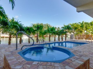Lovely canal-front condos for large groups! Private pool, hot tub, ocean access