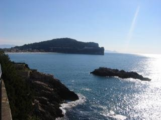 Panorama of Serapo bay. In the foreground you can see the rock called 'La Nave' (the ship).