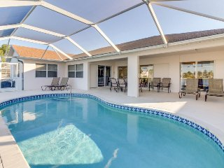 Charming home w/ a screened-in pool set on five acres with two lakes!