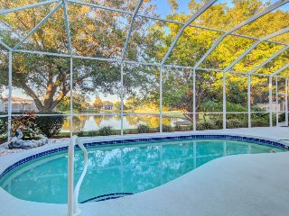 Lakefront gated community home with private heated pool.
