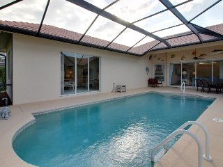 Roomy home with private enclosed pool, great location, and more!