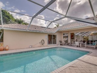 Spacious home with pool boasts a great location in a gated community!