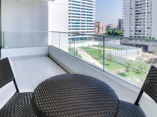 Modern condo with private balcony, nice location, shared sauna and pool!