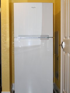 Full-size refrigerator with top freezer and ice-maker