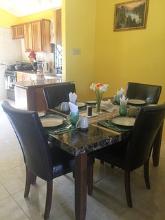 Home Sweet Getaway...dinning table and kitchen fully equipped with all the necessary comfort wares