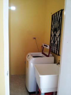 Home Sweet Getaway...washroom, washing machine, house cleaning tools, clothes baskets