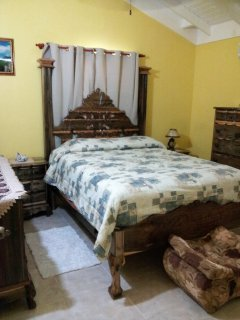 Home Sweet Getaway...front bedroom, chest of drawers and bedside tables and chairs