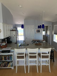Full size fridge and stove with small dishwasher. Fully equipped kitchen!!