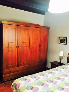 Large wardrobes in each room.