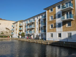 A two bedroom  ground floor apartment  with large patio on the water's edge
