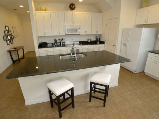 This is a Pool Home property, fully furnished, with a full kitchen, and has all linens and towels, located at Rosemont Woods at Providence Community.