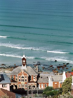 Muizenberg trainstation, Surfers Corner and surfing beach in background.