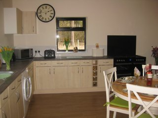 Open plan living area, fully fitted kitchen and dining area.