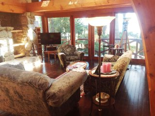 Delightful warm and charming interior, stone fireplace, antiques and views!
