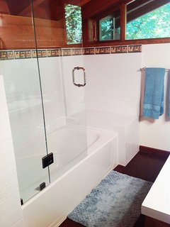 Full bath  and shower with attention to detail and light filled.