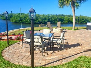 Water Lover's Delight! 3/2 fully renovated home with boat ramp & davits.