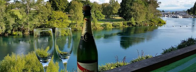 Champagne views of the blue waters of the Waikato River as it flows past the apartment