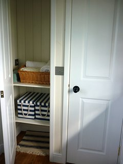Storage cupboard with hanging space for coats