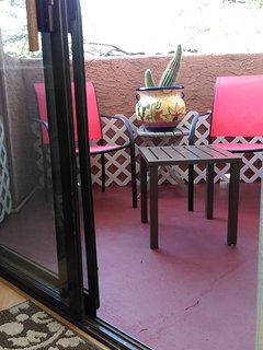 patio with chairs and table (sun umbrella in patio closet)