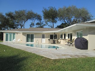 Travertine marble pool deck,  lounges, sunning area, Gas BBQ, two tables.