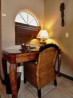 Antique desk on Living Room level with high-speed wireless internet