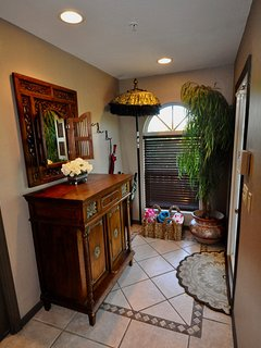 Entrance area with antique south seas console and mirror