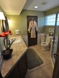 Master bathroom with monogrammed 'Compass Rose' plush bathrobes