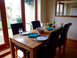 Dining area for four, with view over garden.