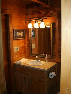 Full bath with shower/tub combo as well as washer and dryer.