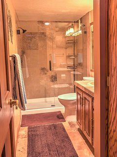 You'll look forward to freshening up in this pristine bathroom.