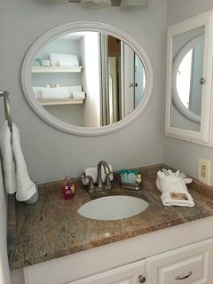 Remodeled Bath includes new vanity, mirror, medicine cabinet and towel rings and rods.