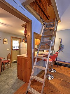 Access to the attic, where you'll find additional sleeping, can be found next to the kitchen.