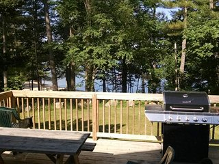 Lakeview home w/ deck, outdoor fireplace & sunset views - steps to sandy beach!