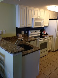 New upgraded, full equipped kitchen with granite countertop