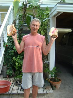 Husband Mark with conch shells.