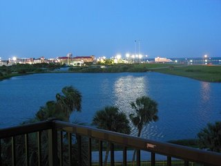 Early evening from your balcony with lights from  Jimmy\'s Fishing Pier
