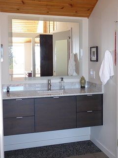 One of the two vanities in the master bath. East