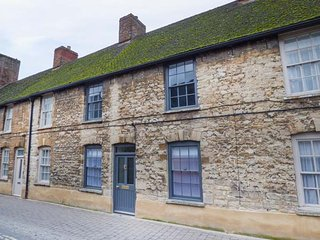 NUMBER 5, high quality accommodation, town location, open fire, courtyard, in