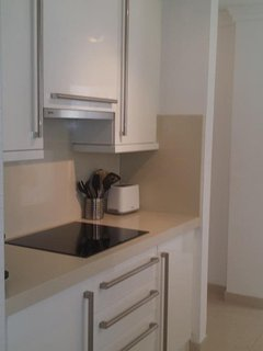 Small Renovated kitchen facing entrance-Vacation Rent Nueva Andalucia Marbella First Line Aloha Golf